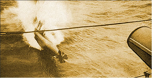 Photograph of torpedo being launched from a German destroyer.